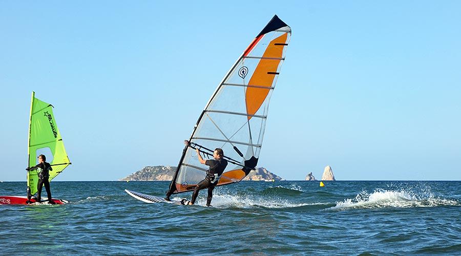 Father and son surfing in El Grau beach